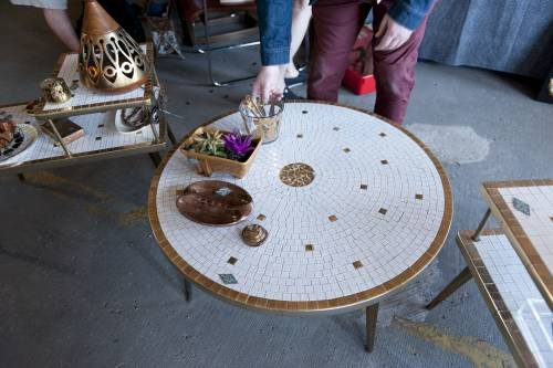 Mid century modern furniture topped round table.