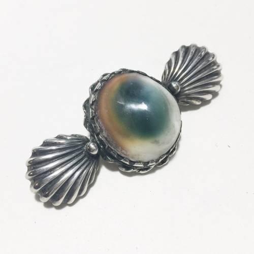 Vintage estate jewelry, operculum set in sterling.