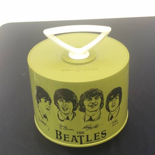 Beatles green 45 record holder container brought into Vintage Garage Chicago. Appraisal Fair.