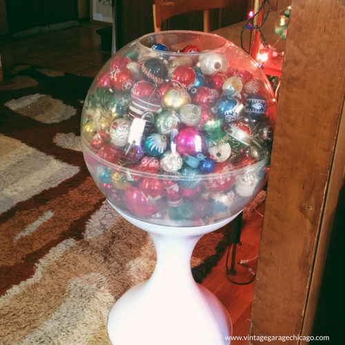 vintage 1970's terrarium filled with vintage Christmas ornament.