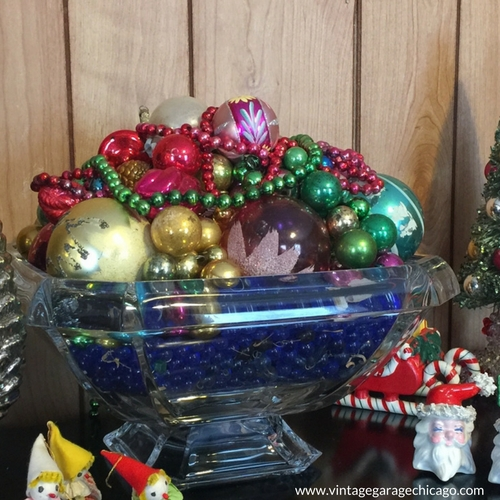 French crystal bowl full of vintage Christmas ornaments.