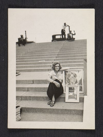 Gertrude Abercrombie on the steps with her painting and artwork