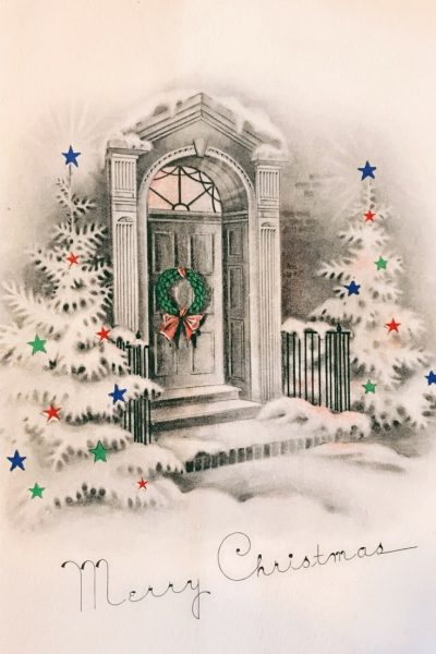 Vintage Merry Christmas greeting card. I love the decorated trees flanking the door and wreath.