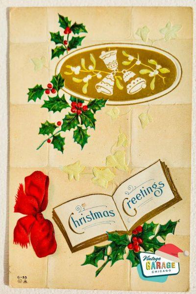 Vintage Christmas at Vintage Garage Chicago. Holiday postcard- Christmas Greetings vintage postcard holly and red bell. Christmas Greetings