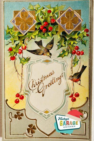 Vintage Christmas at Vintage Garage Chicago. Turn of the century vintage postcard Christmas Greetings bird holly 4 leaf clovers vintage postcard