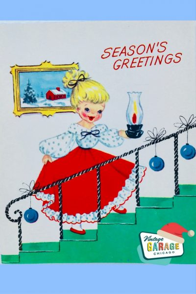 PIN- VINTAGE CHRISTMAS CARD little girl in a red dress Season's Greetings with Christmas ornaments lining the rail up the stairs.