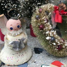 Vintage Kitschmas silver angel ornament modernist ornaments and bottle brush wreaths. Vintage Christmas at Vintage Garage Chicago.