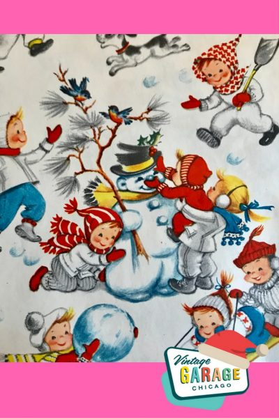 Vintage gift wrapping paper with kids building a snowman 1960s.