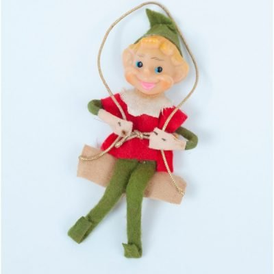 Elf on a Shelf, 3 vintage elves, made in Japan as knee huggers. This guy is swinging on a swing dressed in green and red.